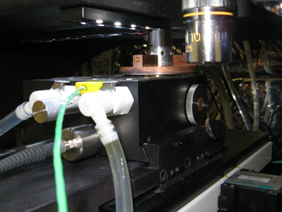 Laser heater tray mounted in nanoindenter